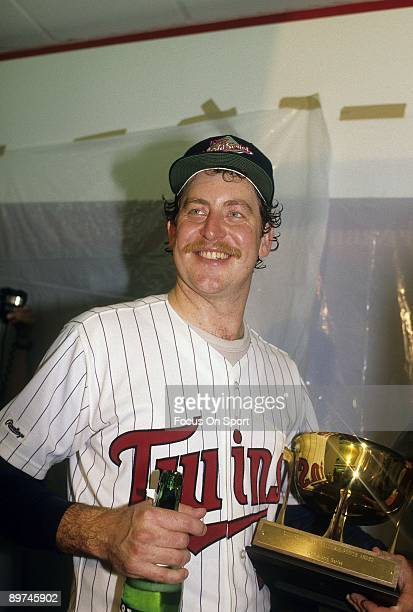 Pitcher Frank Viola of the Minnesota Twins in the locker room a bottle of champagne and the MVP trophy after the Twins defeated the St Louis...