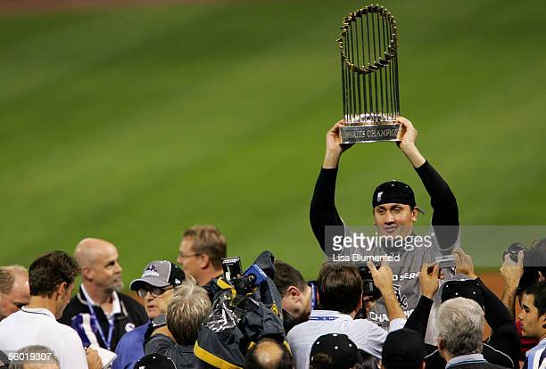 Pitcher Freddy Garcia of the Chicago White Sox celebrates with the Championship Trophy after winning Game Four of the 2005 Major League Baseball...