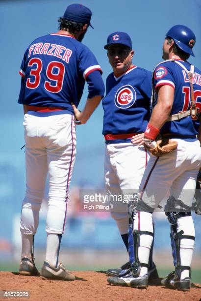 Pitcher George Frazier manager Jim Frey and catcher Steve Lake of the Chicago Cubs have a discussion on the mound during a game against the Los...