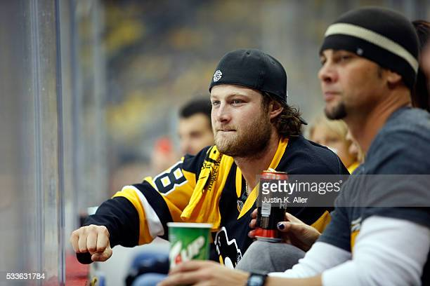MLB pitcher Gerrit Cole of the Pittsburgh Pirates cheers in Game Five of the Eastern Conference Final between the Pittsburgh Penguins and the Tampa...