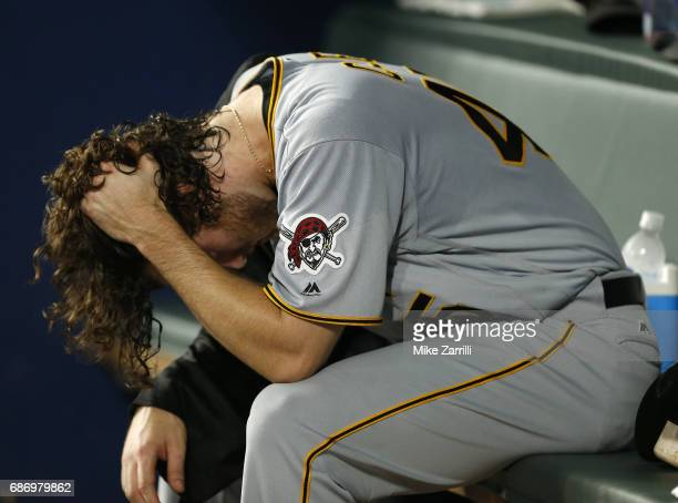 Pitcher Gerrit Cole of the Pittsburgh Pirates reacts in the dugout after leaving the game in the fifth inning during the game against the Atlanta...
