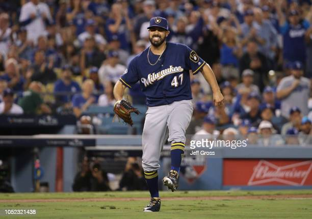 Pitcher Gio Gonzalez of the Milwaukee Brewers hops around in pain after twisting his ankle during the second inning of Game Four of the National...