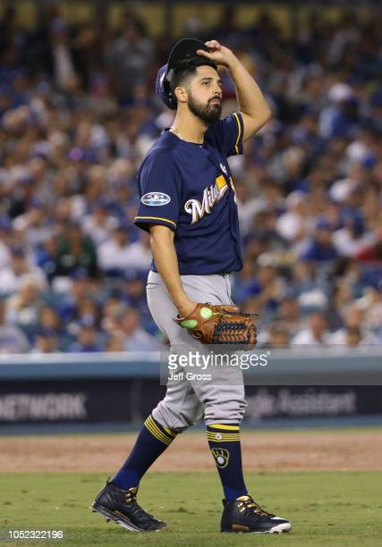 Pitcher Gio Gonzalez of the Milwaukee Brewers takes off his hat during the second inning of Game Four of the National League Championship Series...
