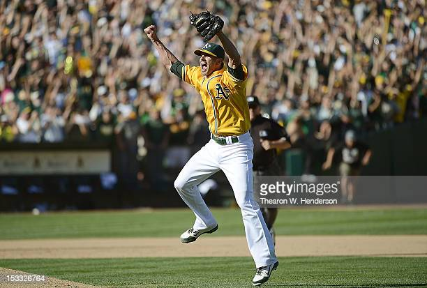 Pitcher Grant Balfour of the Oakland Athletics celebrates defeating the Texas Rangers 12 to 5 and capturing the American League West title at Oco...