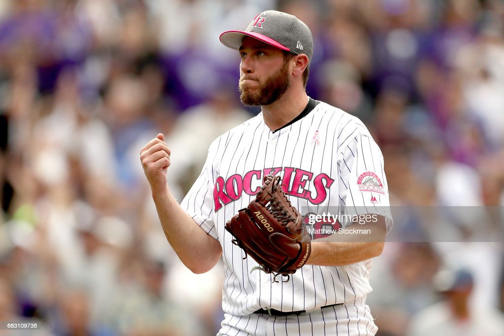 Pitcher Greg Hoilland #56 of the Colorado Rockies celebrates the last out in the ninth inning against the Los Angeles Dodgers at Coors Field on May 14, 2017 in Denver, Colorado. Members of both teams were wearing pink in commemoration of Mother's Day weekend.