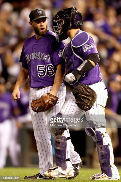 Pitcher Greg Holland and catcher Tony Wolters of the Colorado Rockies celebrate after the last out in the ninth inning against the San Diego Padres...