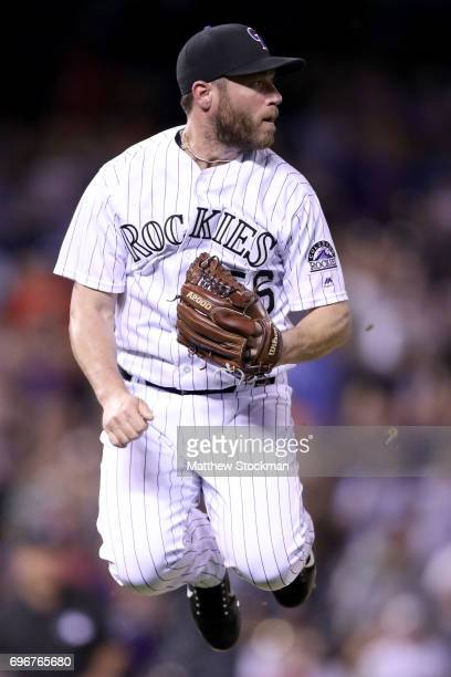 Pitcher Greg Holland of the Colorado Rockies jumps to avoid a ball hit by Joe Panik of the San Francisco Giants in the ninth inning at Coors Field on...