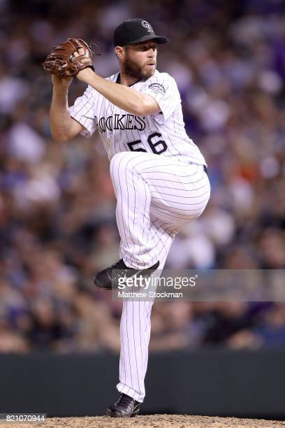 Pitcher Greg Holland of the Colorado Rockies throws in the ninth inning against the Pittsburgh Pirates at Coors Field on July 22 2017 in Denver...