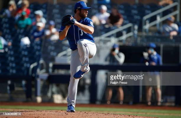 Pitcher Greg Holland of the Kansas City Royals prepares to throw against the Seattle Mariners during the seventh inning of the MLB spring training...