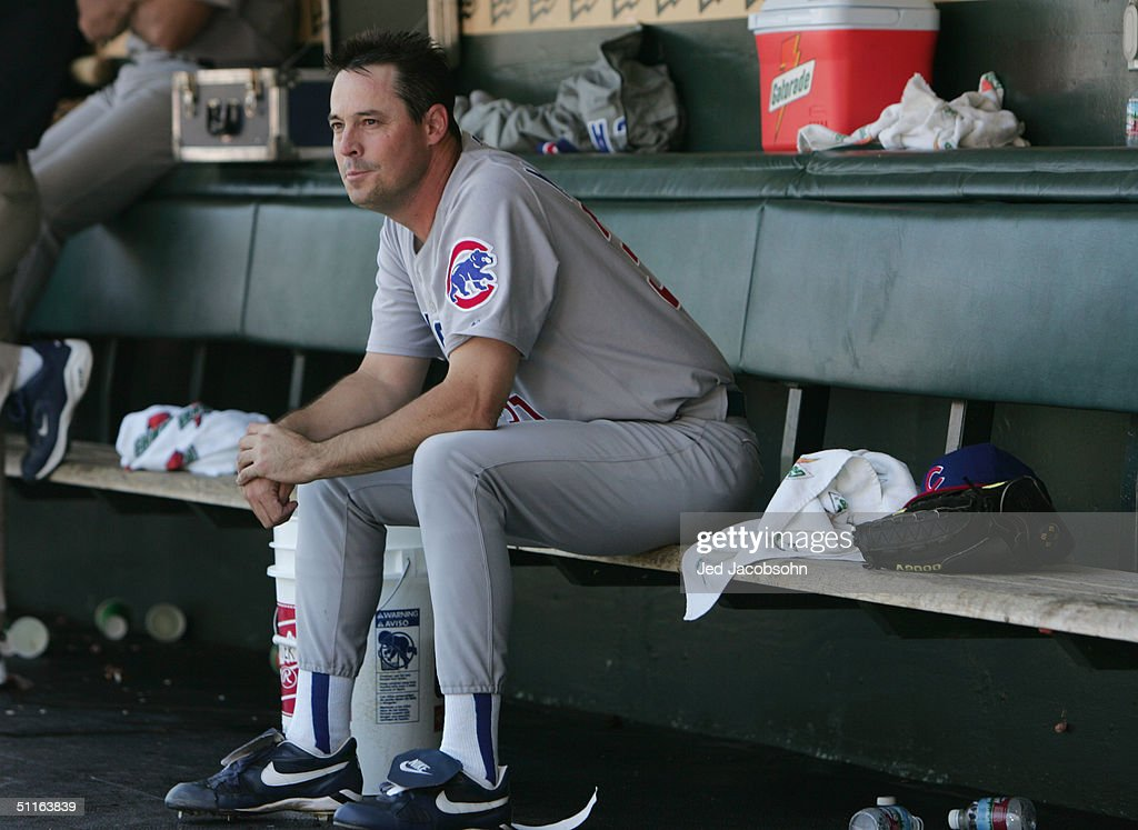 Pitcher Greg Maddux #31 of the Chicago Cubs looks on from the dugout against the San Francisco Giants during the MLB game at SBC Park on August 7, 2004 in San Francisco, California. Greg Maddux wins his 300th game as the Cubs defeated the Giants 8-4.