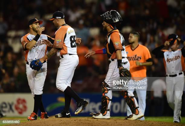 Pitcher Hassan Pena of Aguilas del Zulia from Venezuela celebrates victory with teammates over Alazanes de Granma from Cuba following their Caribbean...