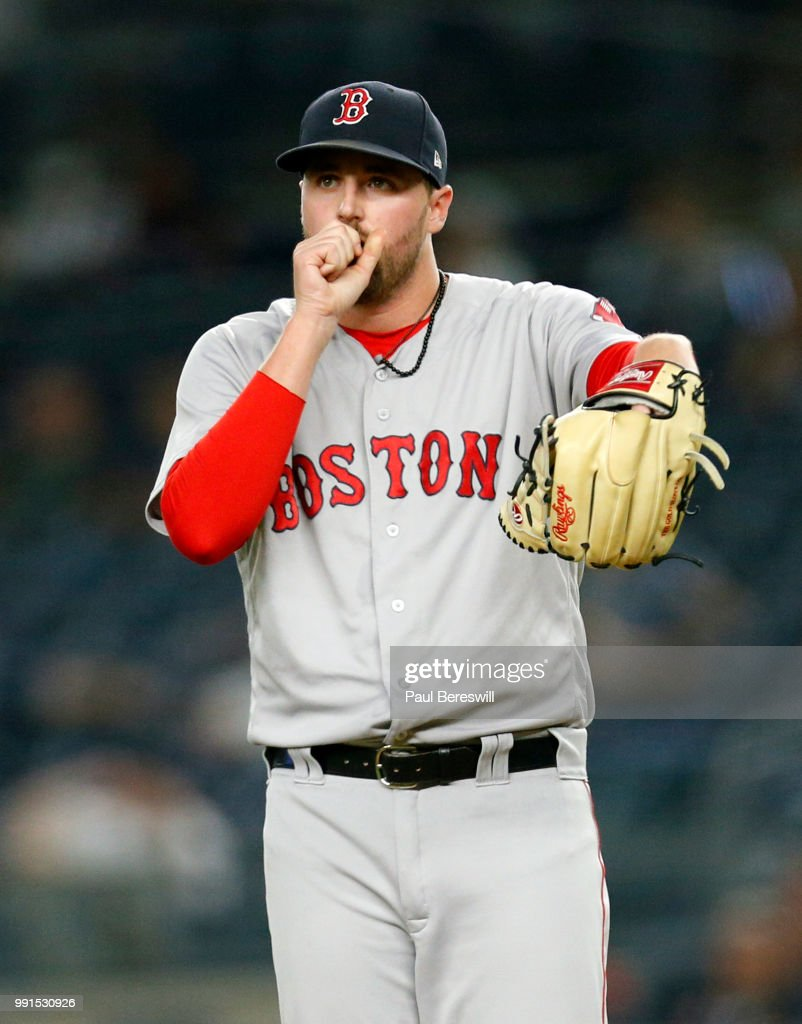 Pitcher Heath Hembree #37 of the Boston Red Sox reacts as he pitches in relief in an MLB baseball game against the New York Yankees on June 30, 2018 at Yankee Stadium in the Bronx borough of New York City. Boston won 11-0.