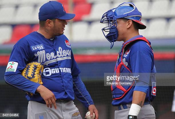 Pitcher Hector Velazquez and catcher Daniel Sanchez of Acereros de Monclova talk during the match between Acereros de Monclova and Guerreros de...