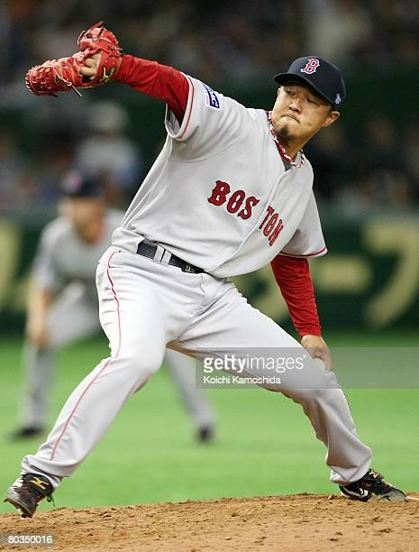 Pitcher Hideki Okajima of Boston Red Sox pitches during a preseason friendly between Boston Red Sox and Yomiuri Giants at Tokyo Dome on March 23,...