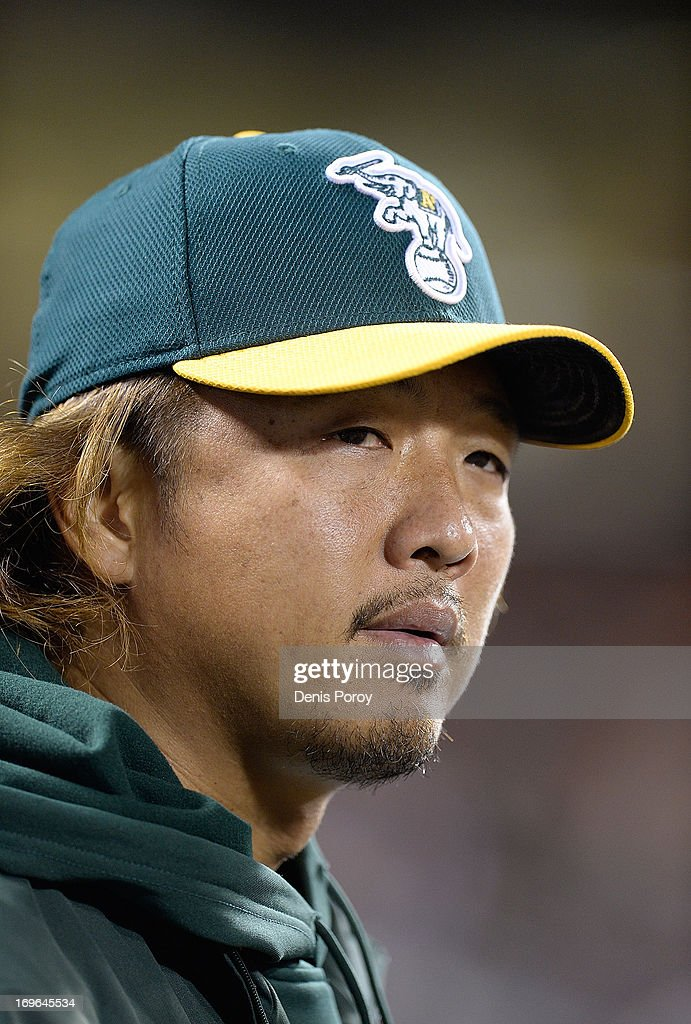 Pitcher Hideki Okajima #39 of the Oakland Athletics looks on from the dugout against the San Francisco Giants in the seventh inning at AT&T Park on May 29, 2013 in San Francisco, California.