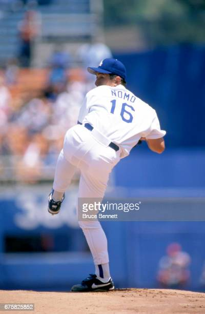Pitcher Hideo Nomo of the Los Angeles Dodgers pitches during an MLB game against the Cincinnati Reds on July 30, 1995 at Dodger Stadium in Los...