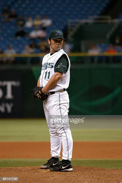 Pitcher Hideo Nomo of the Tampa Bay Devil Rays prepares to pitch against the Milwaukee Brewers on June 15 2005 at Tropicana Field in Tampa Florida...