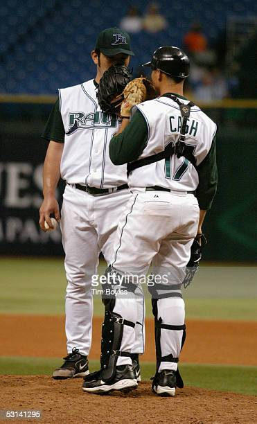 Pitcher Hideo Nomo of the Tampa Bay Devil Rays talks to his catcher Kevin Cash during the game against the Milwaukee Brewers on June 15 2005 at...