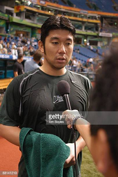 Pitcher Hideo Nomo of the Tampa Bay Devil Rays talks to the press after the game against the Milwaukee Brewers on June 15 2005 at Tropicana Field in...