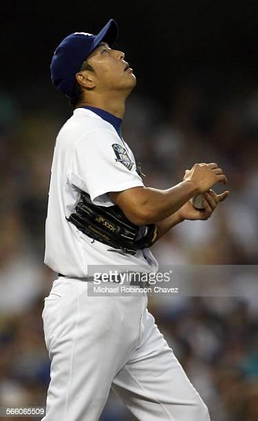 Pitcher Hiroki Kuroda looks skyward after giving up a home run to Diamondback's Miguel Montero in the 3rd inning The Arizona Diamondbacks played the...