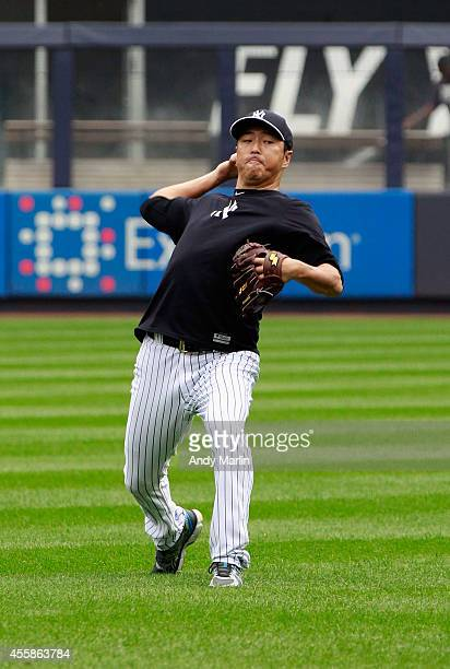 Pitcher Hiroki Kuroda of the New York Yankees warms up in the outfield prior to the game against the Toronto Blue Jays at Yankee Stadium on September...