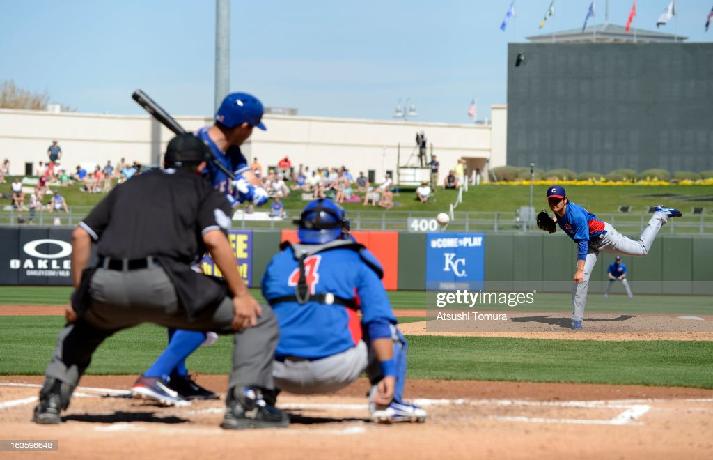 Pitcher Hisanori Takahashi #47 of Chicago Cubs throws during a spring training game against Texas Rangers on March 6, 2013 in Surprize, Arizona.