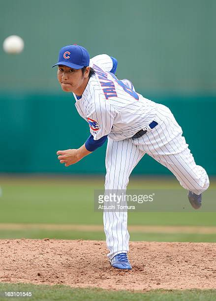 Pitcher Hisanori Takahashi of Chicago Cubs throws during the spring training match against Milwaukee Brewers on March 3 2013 in Mesa Arizona