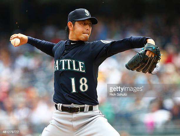 Pitcher Hisashi Iwakuma of the Seattle Mariners delivers a pitch against the New York Yankees in the first inning during a MLB baseball game against...