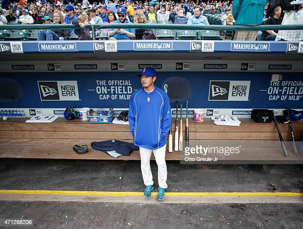 Pitcher Hisashi Iwakuma of the Seattle Mariners looks on from the dugout prior to the game against the Minnesota Twins at Safeco Field on April 26...