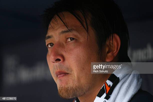 Pitcher Hisashi Iwakuma of the Seattle Mariners looks on from the dugout during the first inning against the New York Yankees during a MLB baseball...