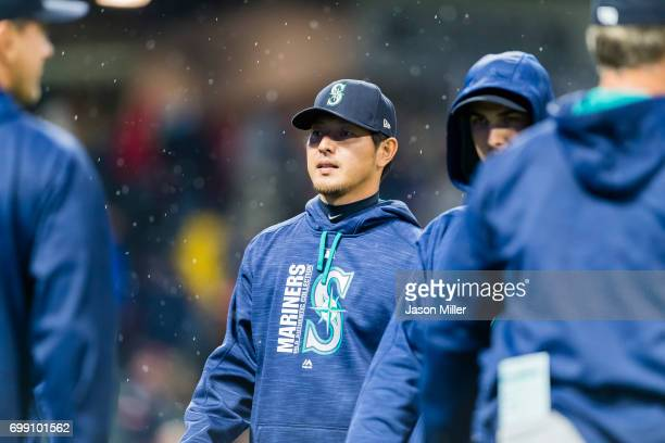 Pitcher Hisashi Iwakuma of the Seattle Mariners walks off the field after the end of the game against the Cleveland Indians at Progressive Field on...