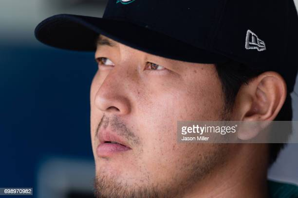 Pitcher Hisashi Iwakuma of the Seattle Mariners watches from the dugout prior to the game against the Cleveland Indians at Progressive Field on April...
