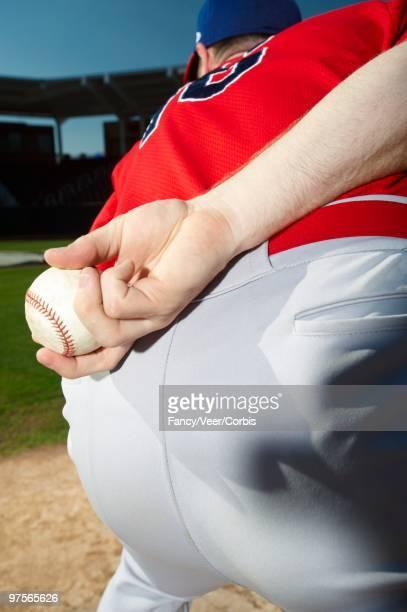 Pitcher holding baseball behind back