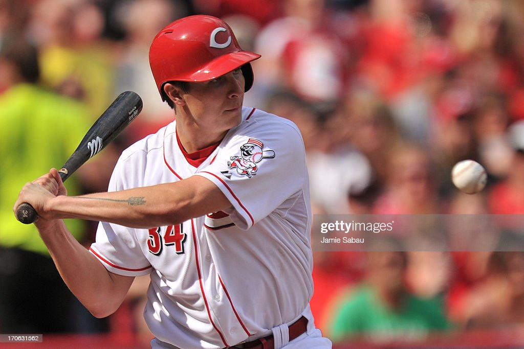 Pitcher Homer Bailey #34 of the Cincinnati Reds bats against the Milwaukee Brewers in the third inning at Great American Ball Park on June 15, 2013 in Cincinnati, Ohio. Milwaukee blanked Cincinnati 6-0.