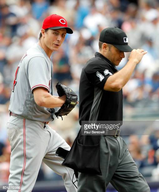 Pitcher Homer Bailey of the Cincinnati Reds talks with umpire Mark Wegner in an interleague MLB baseball game against the New York Yankees on July 26...