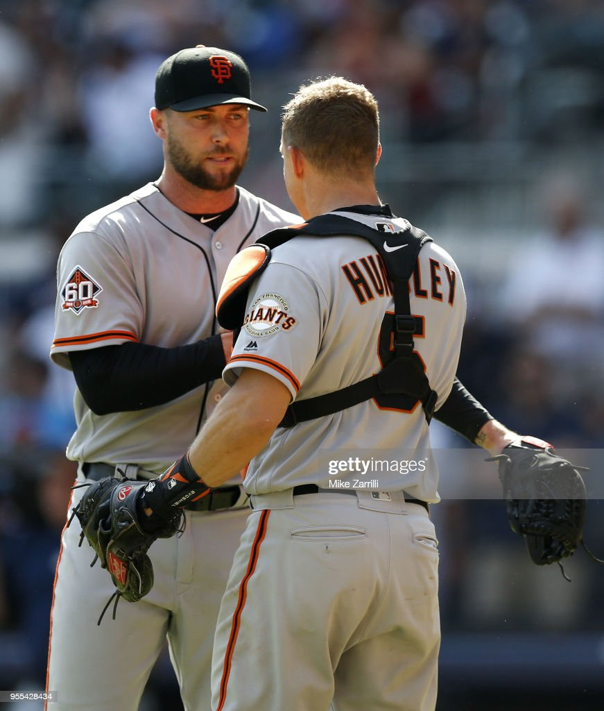 Pitcher Hunter Strickland #60 is congratulated by catcher Nick Hundley #5 of the San Francisco Giants after the game against the Atlanta Braves at SunTrust Park on May 6, 2018 in Atlanta, Georgia.