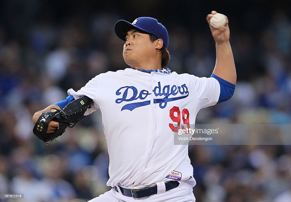 Pitcher Hyun-Jin Ryu #99 of the Los Angeles Dodgers pitches in the first inning against the Colorado Rockies during the MLB game at Dodger Stadium on April 30, 2013 in Los Angeles, California.
