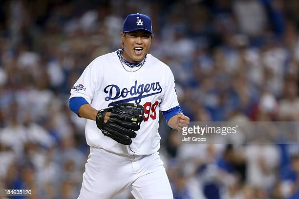Pitcher Hyun-Jin Ryu of the Los Angeles Dodgers reacts after striking out Matt Adams of the St. Louis Cardinals in the seventh inning in Game Three...