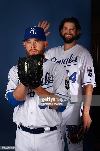 Pitcher Ian Kennedy of the Kansas City Royals poses for a portrait as Luke Hochevar steps in during spring training photo day at Surprise Stadium on...