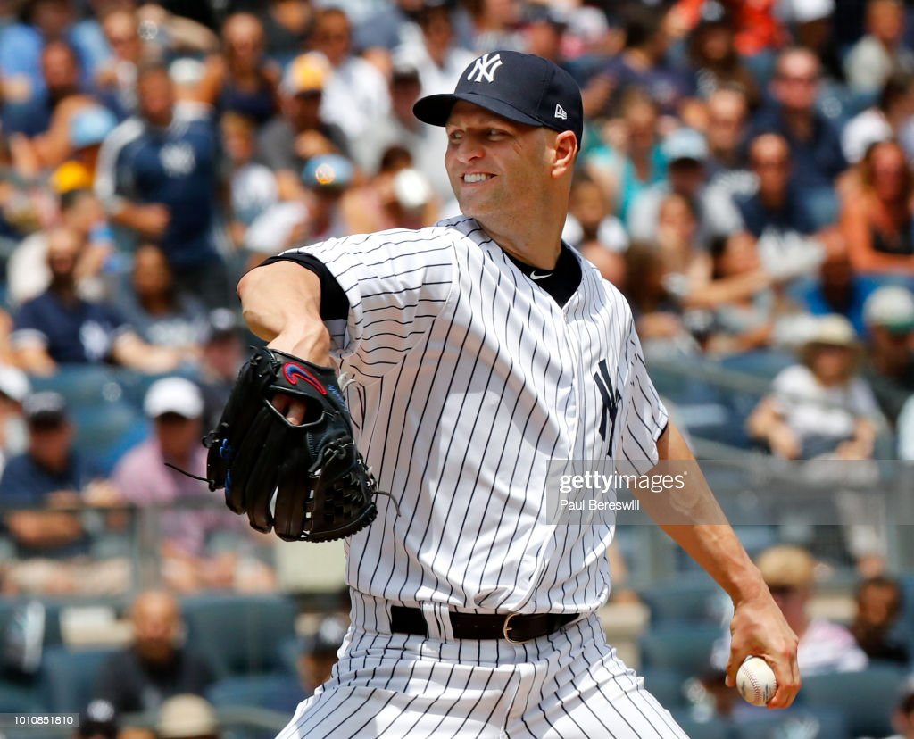 Pitcher J.A. Happ #34 of the New York Yankees pitches in his first game as a Yankee since recently being acquired in a trade with the Toronto Blue Jays during an MLB baseball game against the Kansas City Royals on July 29, 2018 at Yankee Stadium in the Bronx borough of New York City. Yankees won 6-3.