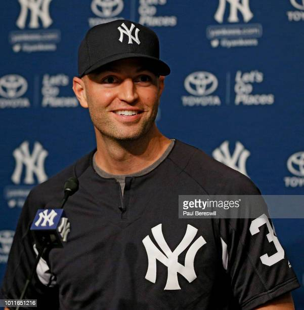 Pitcher JA Happ talks to the media about being traded to the New York Yankees after an MLB baseball game against the Kansas City Royals on July 28...