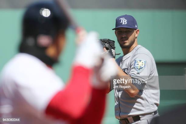 Pitcher Jacob Faria of the Tampa Bay Rays readies for the pitch against Mookie Betts of the Boston Red Sox in the first inning at Fenway Park on...