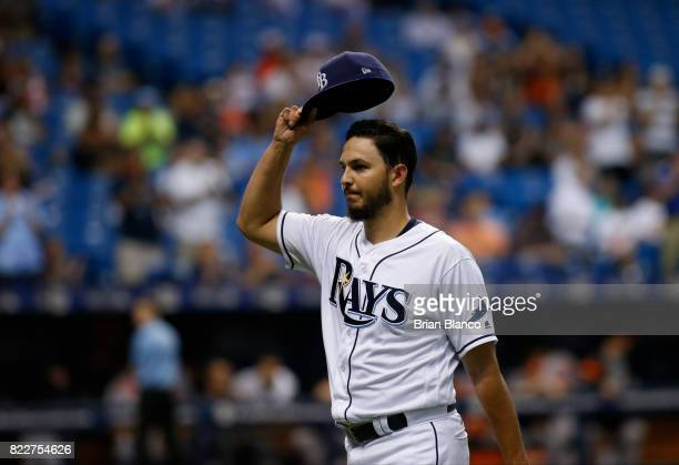 Pitcher Jacob Faria of the Tampa Bay Rays tips his hat to the crowd as he makes his way to the dugout after being taken off the mound by manager...