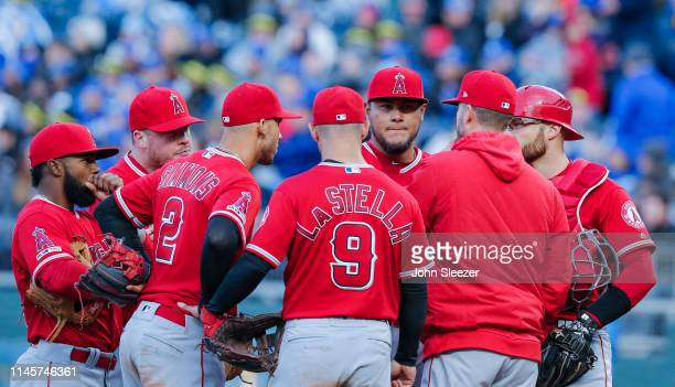 Pitcher Jaime Barria of the Los Angeles Angels of Anaheim listens to pitching coach Doug White in the third inning during the game against the Kansas...