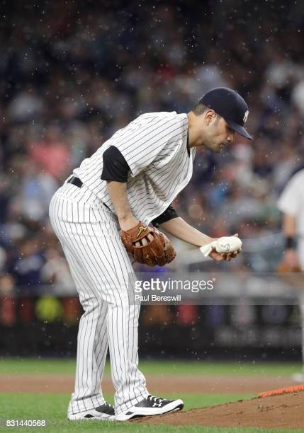 Pitcher Jaime Garcia of the New York Yankees picks up the rosin bag in an MLB baseball game against the Boston Red Sox on August 11 2017 at Yankee...