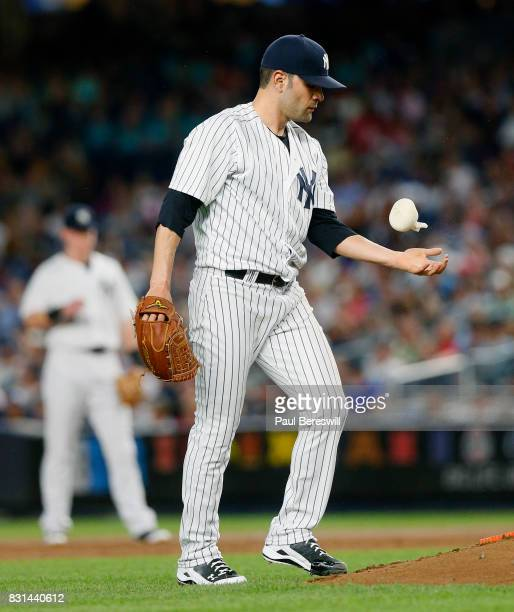 Pitcher Jaime Garcia of the New York Yankees reacts by bouncing the rosin bag on his forearm in an MLB baseball game against the Boston Red Sox on...