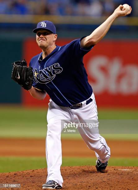 Pitcher Jake McGee of the Tampa Bay Rays pitches against the Oakland Athletics during the game at Tropicana Field on August 25 2012 in St Petersburg...