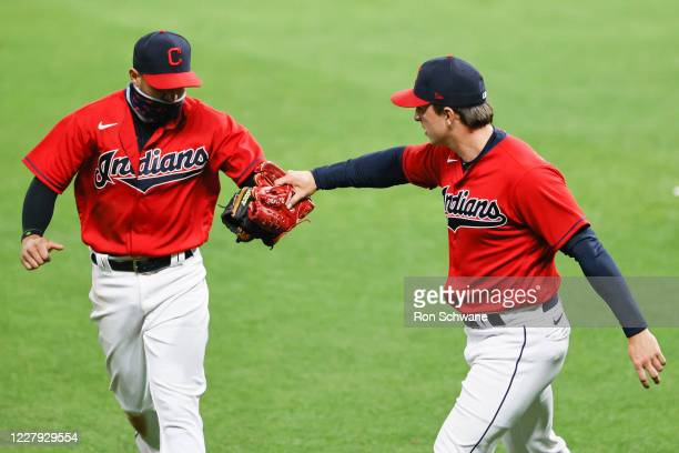 Pitcher James Karinchak of the Cleveland Indians celebrates with Cesar Hernandez after getting Joey Votto of the Cincinnati Reds to ground into a...