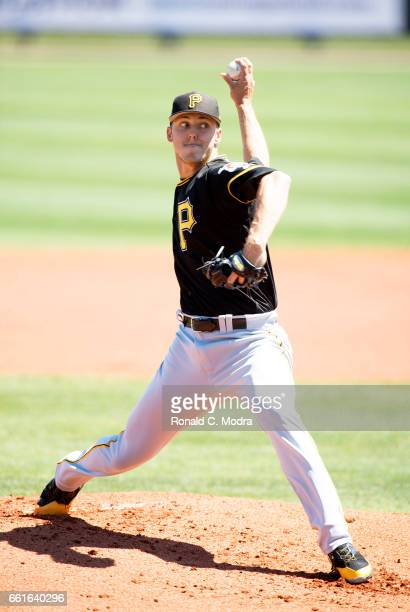 Pitcher Jameson Taillon of the Pittsburgh Pirates pitches during a spring training game against the Tampa Bay Rays at Charlotte Sports Park on March...