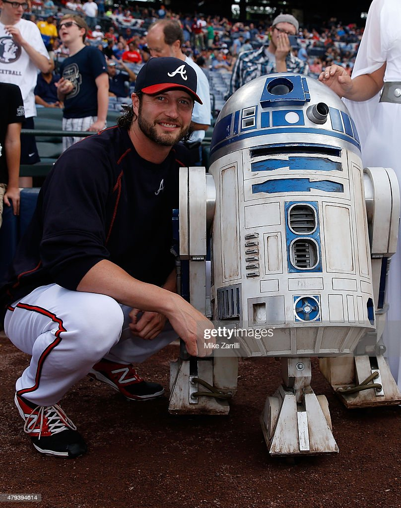 Pitcher Jason Grilli #39 of the Atlanta Braves poses for a picture with R2-D2 during pre-game Star Wars Night festivities before the game against the Philadelphia Phillies at Turner Field on July 3, 2015 in Atlanta, Georgia.